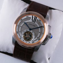 Calibre de Cartier Flying Tourbillon mens watch grey dial two-tone pink gold steel brown leather strap
