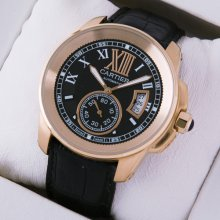 Calibre de Cartier pink gold automatic mens watch black dial and leather strap