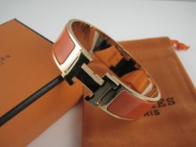 Hermes Orange Enamel Clic H Bracelet Narrow Width (18mm) In Gold